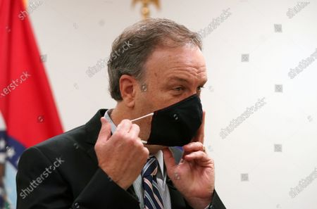 Stock Picture of St. Louis County Executive Dr. Sam Page removes his mask before addressing the mask mandate he put into place that was rejected by the St. Louis County Council during his weekly press conference in Clayton, Missouri on Wednesday, July 28, 2021. In an effort to stop the new delta variant, an indoor mask mandate went into effect on July 26, 2021 requiring all county and city residents, regardless of vaccination status, to wear masks inside public locations and transportation.