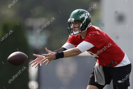 New York Jets quarterback Mike White tosses the ball during NFL football practice, in Florham Park, N.J