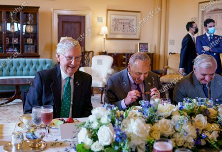 Senate Minority Leader Mitch McConnell, R-Ky., left, and Senate Majority Leader Chuck Schumer, D-N.Y., center, joined at right by Sen. Jack Reed, D-R.I., are seated together during a luncheon for Iraqi Prime Minister Mustafa Al-Kadhimi, at the Capitol in Washington, . Senate Republicans have just reached a deal with Democrats over major outstanding issues in a $1 trillion infrastructure bill and say they are ready to vote to take up the bill