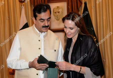 Prime Minister Yousaf Raza Gillani presents the Holy Quran to Angelina Jolie, Goodwill Ambassador UNHCR