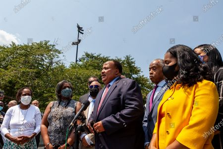Martin Luther King III speaks at a press conference with the Texas Black Legislative Caucus, Rev. Al Sharpton, and Arndrea King on voting rights at the Martin Luther King Jr. Memorial.  Caucus members are in Washington, DC, while breaking quorum to prevent passage of a bill regricting voting rights in the Texas legislature.  Left to right: Rep. Sheryl Cole, Rep. Rhetta Bowers, Rep. Carl Sherman, Martin Luther King III, Al Sharpton, Arndrea King, Rep. Shawn Thierry