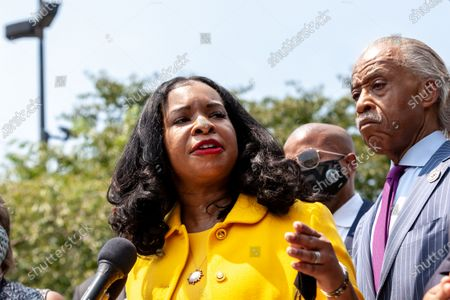 Arndrea King speaks at a press conference with the Texas Black Legislative Caucus, Martin Luther King III, and Rev. Al Sharpton on voting rights at the Martin Luther King Jr. Memorial.  Caucus members are in Washington, DC, while breaking quorum to prevent passage of a bill regricting voting rights in the Texas legislature.
