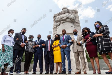 Rev. Al Sharpton leads members of the Texas Black Legislative Caucus, Martin Luther King III, and Arndrea King in prayer at the end of a press conference on voting rights at the Martin Luther King Jr. Memorial.  Caucus members are in Washington, DC, while breaking quorum to prevent passage of a bill regricting voting rights in the Texas legislature.  Left to right: Rep. Sheryl Cole, Rep. Jarvis Johnson, Rep. Rhetta Bowers, Martin Luther King III, Arndrea King, Rev. Al Sharpton, Rep. Carl Sherman, Rep. Jasmine Crockett, and Rep. Shawn Thierry.