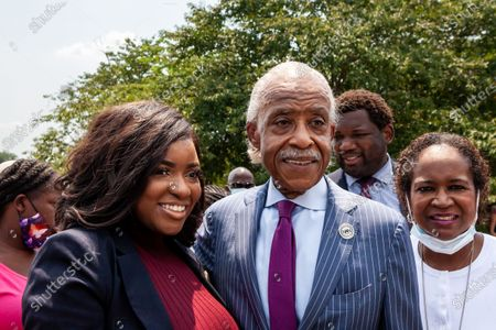Rev. Al Sharpton takes a photo with two members of the Texas Black Legislative Caucus following a press conference on voting rights that also included Martin Luther King III, and Arndrea King, at the Martin Luther King Jr. Memorial.  Caucus members are in Washington, DC, while breaking quorum to prevent passage of a bill regricting voting rights in the Texas legislature. Left to right: Rep. Jasmine Crockett, Rev. Al Sharpton, and Rep. Sheryl Cole.