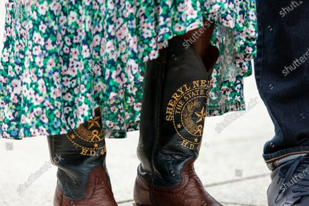 Rep. Sheryl Cole wears her custom cowboy boots, embroidered with her name, district,and Texas seal, at a press conference with the Texas Black Legislative Caucus, Martin Luther King III, and Rev. Al Sharpton on voting rights at the Martin Luther King Jr. Memorial.  Caucus members are in Washington, DC, while breaking quorum to prevent passage of a bill regricting voting rights in the Texas legislature.