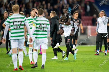 Midtjylland players Awer Mabil (C) and Pione Sisto (up) celebrate after winning the UEFA Champions League second qualifying round, second leg soccer match between FC Midtjylland and Celtic Glasgow in Herning, Denmark, 28 July 2021.