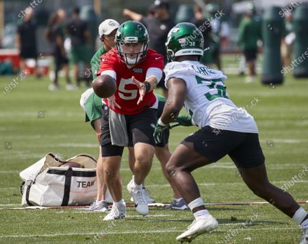 Stock Picture of , 2021, Florham Park, New Jersey, USA: New York Jets quarterback Mike White (5) and running back Michael Carter (32) take part in a drill during morning training camp session at the Atlantic Health Jets Training Center, Florham Park, New Jersey