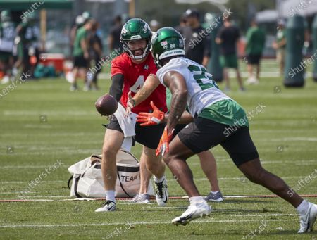 , 2021, Florham Park, New Jersey, USA: New York Jets quarterback James Morgan (4) and running back La'Mical Perine (22) take part in a drill during morning training camp session at the Atlantic Health Jets Training Center, Florham Park, New Jersey