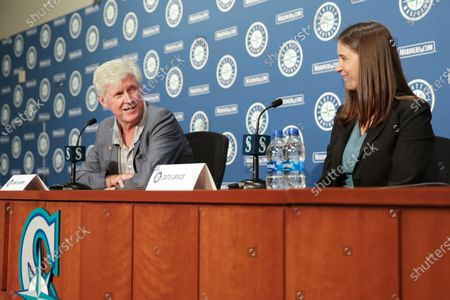 Catie Griggs, right, is introduced as the Seattle Mariners' new president of business operations by John Stanton, the team's chairman and managing partner, during a baseball a press conference on