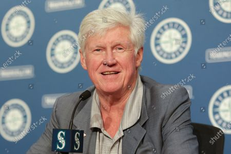Seattle Mariners chairman and managing partner John Stanton introduces Catie Griggs as the team's new president of business operations during a baseball press conference in Seattle on