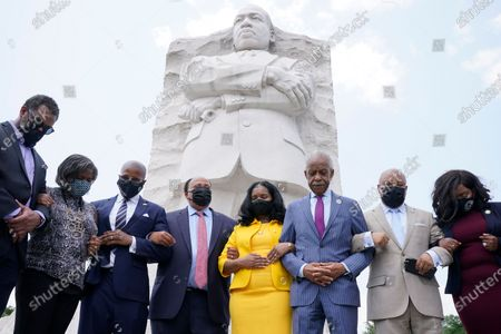 Stock Picture of From left, Texas State Representatives Rep. Jarvis Johnson, Rep. Rhetta Bowers, Rep. Ron Reynolds, Martin Luther King III, Arndrea Waters King, Rev. Al Sharpton, Rep. Carl Sherman, and Rep. Jasmine Crockett, pray after a news conference with the Texas State Democratic Delegation at the Martin Luther King, Jr. Memorial, in Washington