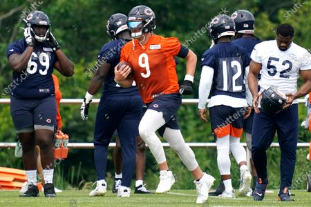 Chicago Bears quarterback Nick Foles (9) runs on the field during NFL football practice in Lake Forest, Ill