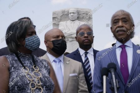 The sculpture of Martin Luther King III Jr., is seen behind from left, Texas State Rep. Rhetta Bowers, Rep. Carl Sherman, Rep. Ron Reynolds, and Rev. Al Sharpton, during a news conference with the Texas State Democratic Delegation at the Martin Luther King, Jr. Memorial, in Washington