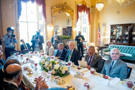 United States Senate Majority Leader Chuck Schumer (Democrat of New York), second from right, is seated with United States Senator Lisa Murkowski (Republican of Alaska), left, United States Senator Jim Inhofe (Republican of Oklahoma), second from left, United States Senate Minority Leader Mitch McConnell (Republican of Kentucky), third from right, and United States Senator Jack Reed (Democrat of Rhode Island), right, for a bipartisan Senate meeting with His Excellency Mustafa Al-Kadhimi, Prime Minister of the Republic of Iraq at the US Capitol in Washington, DC,.