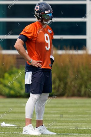 Chicago Bears quarterback Nick Foles watches teammates during NFL football practice in Lake Forest, Ill