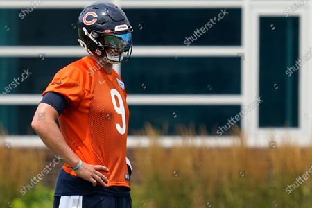 Stock Picture of Chicago Bears quarterback Nick Foles watches teammates during NFL football practice in Lake Forest, Ill