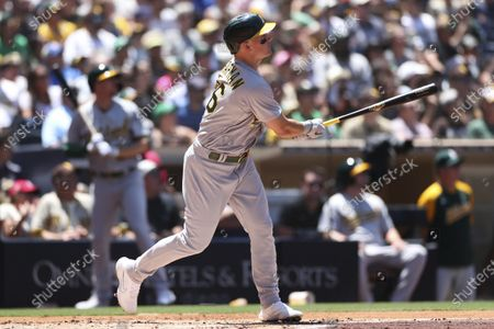 Oakland Athletics' Matt Chapman watches his home run off San Diego Padres starting pitcher Blake Snell in the first inning of a baseball game, in San Diego