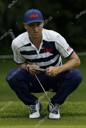 Stock Image of United States' Justin Thomas studies the third green during the first round of the men's golf event at the 2020 Summer Olympics, at the Kasumigaseki Country Club in Kawagoe, Japan