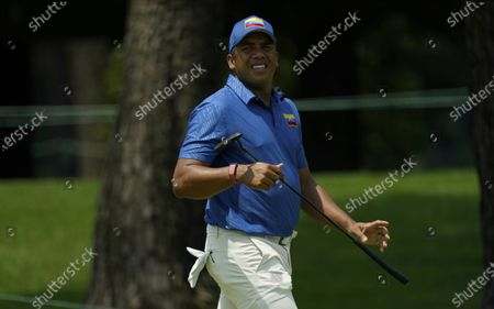 Venezuela's Jhonattan Vegas gestures on the 11th green during the first round of the men's golf event at the 2020 Summer Olympics the, at the Kasumigaseki Country Club in Kawagoe, Japan