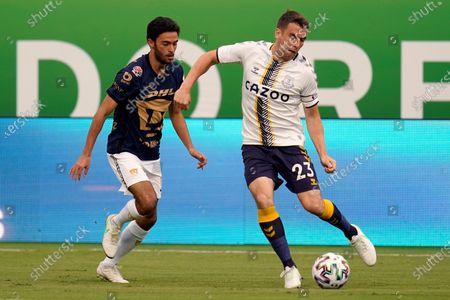 Stock Picture of Everton FC defender Seamus Coleman (23) passes the ball around Pumas defender Jeronimo Rodriguez during the first half of a Florida Cup friendly soccer match, in Orlando, Fla