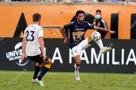 Stock Photo of Pumas defender Jeronimo Rodriguez, left, controls a pass in front of Everton FC defender Seamus Coleman (23) during the first half of a Florida Cup friendly soccer match, in Orlando, Fla