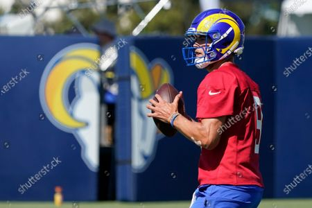 Los Angeles Rams quarterback Matthew Stafford throws during an NFL football camp practice, in Irvine, Calif