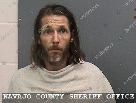 Provided by the Navajo County Sheriff's Office shows Shawn Michael Chock. Chock was charged with several counts of aggravated assault for allegedly plowing his truck into cyclists gathered for a weekend race on June 19, 2021, in Show Low, Ariz. An indictment released, adds a murder charge against Chock in the death of cyclist Jeremy Barrett. He's also charged with aggravated assault of nine other people