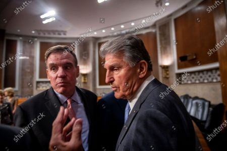 United States Senator Mark Warner (Democrat of Virginia) and United States Senator Joe Manchin III (Democrat of West Virginia) confer with a staff member while United States Senator Rob Portman (Republican of Ohio) and United States Senator Kyrsten Sinema (Democrat of Arizona) respond to questions from reporters after the vote on the motion to invoke cloture to proceed to the consideration of H.R. 3684, the INVEST in America Act on Capitol Hill in Washington, DC. The vote to begin discussion of the bipartisan infrastructure bill agreed to by the White House, was 67 to 32. If passed, the bill would invest close to $1 trillion in roads, bridges, ports and other infrastructure without a major tax increase.