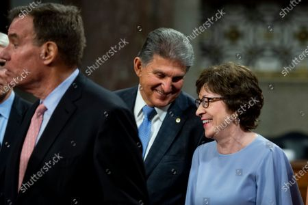 Stock Picture of United States Senator Joe Manchin III (Democrat of West Virginia), center, chats with United States Senator Susan Collins (Republican of Maine), right, while United States Senator Mark Warner (Democrat of Virginia), left, makes remarks after the vote on the motion to invoke cloture to proceed to the consideration of H.R. 3684, the INVEST in America Act on Capitol Hill in Washington, DC. The vote to begin discussion of the bipartisan infrastructure bill agreed to by the White House, was 67 to 32. If passed, the bill would invest close to $1 trillion in roads, bridges, ports and other infrastructure without a major tax increase.