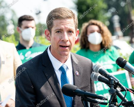 U.S. Representative Mike Levin (D-CA) speaks at a press conference where members of the Congress called for climate action.