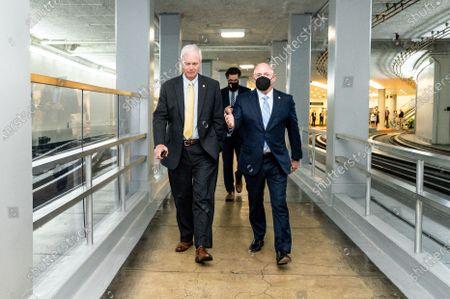 U.S. Senators Ron Johnson (R-WI) and Mark Kelly (D-AZ) walk near the Senate Subway.