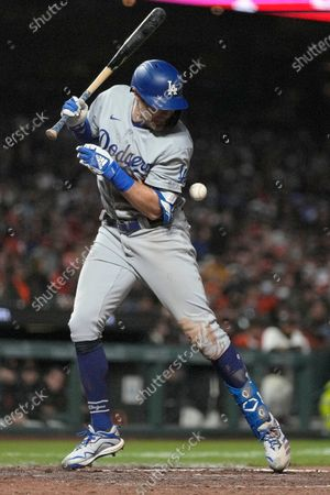 Los Angeles Dodgers' AJ Pollock is hit by a pitch from San Francisco Giants reliever John Brebbia during the seventh inning of a baseball game, in San Francisco