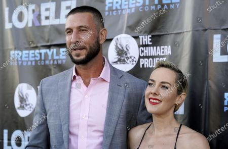 """Pablo Schreiber, left, and Jena Malone, cast members in """"Lorelei,"""" pose together at the Los Angeles premiere of the film at Laemmle Royal on"""