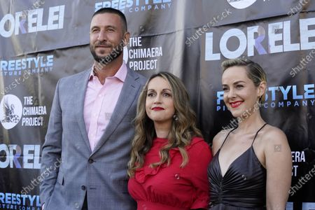"""Sabrina Doyle, center, writer/director of """"Lorelei,"""" poses with cast members Pablo Schreiber, left, and Jena Malone at the Los Angeles premiere of the film at the Laemmle Royal"""