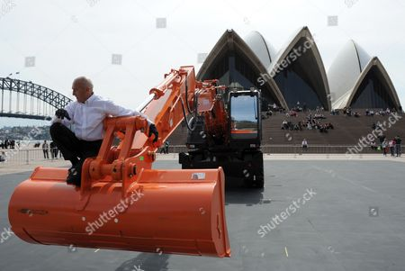 Performer Philippe Priasso dances with a digger