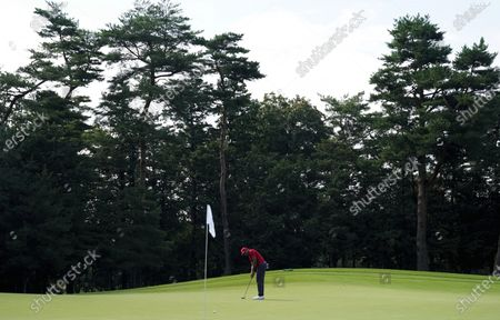 Jhonattan Vegas of Venezuela makes a putt on the fourth hole during the second round of the men's golf event at the 2020 Summer Olympics, at the Kasumigaseki Country Club in Kawagoe, Japan