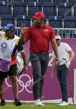 Jhonattan Vegas of Venezuela waves at the first fairway during the second round of the men's golf event at the 2020 Summer Olympics, at the Kasumigaseki Country Club in Kawagoe, Japan