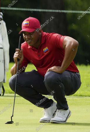 Jhonattan Vegas of Venezuela studies his putt on the first hole during the second round of the men's golf event at the 2020 Summer Olympics, at the Kasumigaseki Country Club in Kawagoe, Japan