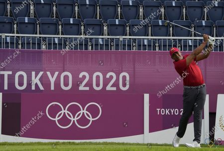 Jhonattan Vegas of Venezuela watches his tee shot on the first hole during the second round of the men's golf event at the 2020 Summer Olympics, at the Kasumigaseki Country Club in Kawagoe, Japan