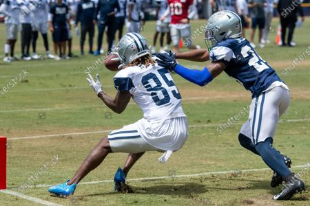 Stock Picture of Dallas Cowboys cornerback Kelvin Joseph (24) breaks up a pass intended for wide receiver Noah Brown (85) at practice at the NFL football team's training camp in Oxnard, Calif
