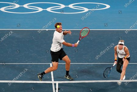 Kevin Krawietz (R) and Laura Siegemund (L) of Germany in action against Novak Djokovic and Nina Stojanovic of Serbia during their Mixed Doubles Tennis quarterfinals match of the Tokyo 2020 Olympic Games at the Ariake Coliseum in Tokyo, Japan, 29 July 2021.