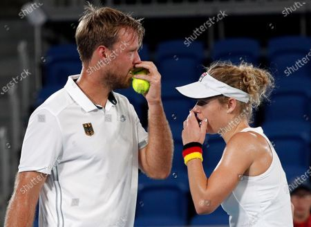 Kevin Krawietz (L) and Laura Siegemund (R) of Germany speak during their Mixed Doubles Tennis quarterfinals match against Novak Djokovic and Nina Stojanovic of Serbia at the Tokyo 2020 Olympic Games at the Ariake Coliseum in Tokyo, Japan, 29 July 2021.