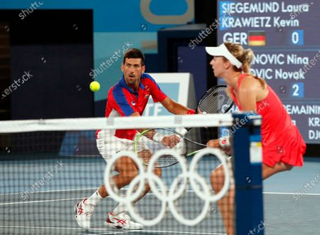 Novak Djokovic (L) and Nina Stojanovic (R) of Serbia in action against Kevin Krawietz and Laura Siegemund of Germany during their Mixed Doubles Tennis quarterfinals match of the Tokyo 2020 Olympic Games at the Ariake Coliseum in Tokyo, Japan, 29 July 2021.