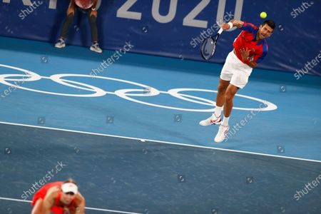 Novak Djokovic (R) and Nina Stojanovic (L) of Serbia in action against Kevin Krawietz and Laura Siegemund of Germany during their Mixed Doubles Tennis quarterfinals match of the Tokyo 2020 Olympic Games at the Ariake Coliseum in Tokyo, Japan, 29 July 2021.