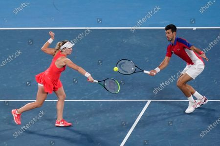 The Serbian mixed doubles team of Nina Stojanovic, left, and Novak Djokovic play during the quarterfinals of the tennis competition at the 2020 Summer Olympics, in Tokyo, Japan