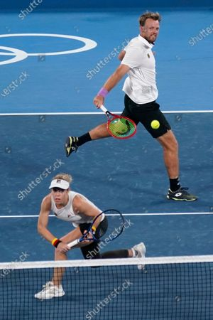 The German mixed doubles team of Laura Siegemund, left, and Kevin Krawietz play during the quarterfinals of the tennis competition at the 2020 Summer Olympics, in Tokyo, Japan