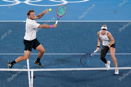 The German mixed doubles team of Laura Siegemund, right, and Kevin Krawietz play during the quarterfinals of the tennis competition at the 2020 Summer Olympics, in Tokyo, Japan