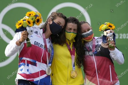 Jessica Fox of Australia, centre, holds the gold medal Mallory Franklin of Britain, left, holds the silver medal and Andrea Herzog of Germany, right, with the bronze medal in the Women's C1 of the Canoe Slalom at the 2020 Summer Olympics, in Tokyo, Japan