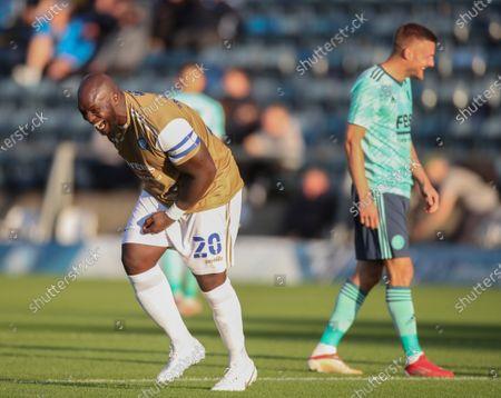 Adebayo Akinfenwa of Wycombe Wanderers with Jamie Vardy of Leicester City