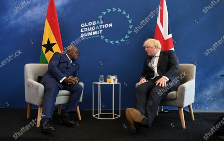 British Prime Minister Boris Johnson (R) with  President of Ghana Nana Addo Dankwa Akufo-Addo at the Global Education Summit in London, Britain, 29 July 2021. The UK and Kenya are hosting the Education Summit in London where leaders from world governments have come together to make pledges to support work to help transform education systems in up to 90 countries and territories.